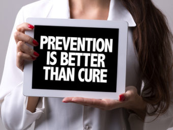 Female doctor holding a tablet with the text: Prevention is Better Than Cure